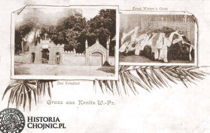 Brama cm. ewangelickiego i wieńce w miejscu pochówku zamordowanego E. Wintera.